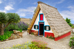 Typical souvernir sweet candy shop house, Madeira. A souvenir shop built like a traditional triangular house of Santana. This shop sells sweets and candy ( stock photos