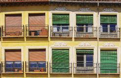 Typical spanish balconies with colourful blinds Royalty Free Stock Photos