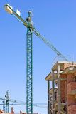 Typical Spanish building site with half built property and crane Stock Photos