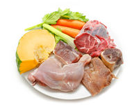 Typical Spanish cuisine. Some ingredients used to prepare spanish stew. Meats and vegetables royalty free stock photo