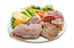 Typical Spanish cuisine. Some ingredients used to prepare spanish stew. Meats and vegetables isolated. Stock Images