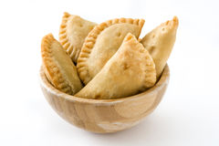 Typical Spanish empanadas in bowl isolated. On white background royalty free stock images