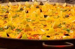 Typical Spanish paella in big pan, street market. Typical Spanish paella in big pan close up , street market royalty free stock photo
