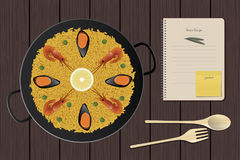 Typical Spanish paella with prawns and mussels. Notebook Royalty Free Stock Images