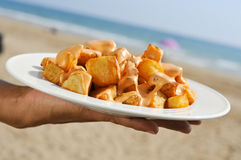 Typical spanish patatas bravas, fried potatoes with a hot sauce, Royalty Free Stock Images