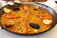 Typical spanish seafood paella in traditional pan Royalty Free Stock Image