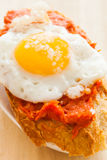 Spanish snack. Typical spanish tapa with quail eggs and sobrasada on a slice of bread Stock Photo