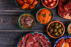 Typical spanish tapas concept, rustic style, top view. royalty free stock photo