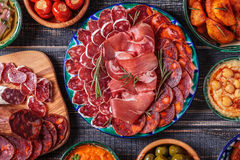 Typical spanish tapas concept, rustic style, top view. stock images