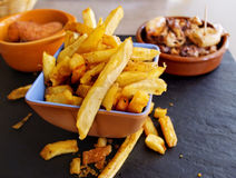 Typical spanish tapas. Fries, croquettes and squid tapas Royalty Free Stock Photos