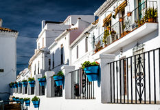 Typical spanish white village houses with flower pots. Royalty Free Stock Photos
