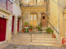 Typical staircase and old traditional houses in Alfama neighborhood, Lisbon. Typical staircase and old traditional houses with colorful doors in Alfama royalty free stock photos
