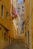 Typical staircase and old traditional houses in Alfama neighborhood, Lisbon. Typical staircase and old traditional houses with laundry hanging out of the windows royalty free stock photography
