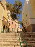 Typical stairs and old traditional houses in Alfama neighborhood, Lisbon. Typical staircase and old traditional houses with laundry hanging out of the windows in stock photography