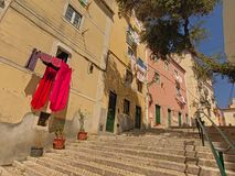 Typical staircase and old traditional houses in Alfama neighborhood, Lisbon. Typical staircase and old traditional houses with laundry hanging out of the windows royalty free stock image