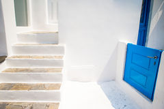 Typical staircase and a small blue door on the cozy streets of Mykonos, Cyclades. Stock Photography