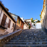 Typical stepped street in Granada, Spain Stock Photo