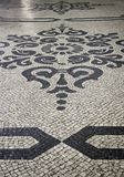 Typical stone floor of Lisbon. Typical stone floor Lisbon, detail of a typical floor with shapes and drawings, art Portugal, tourism stock photography