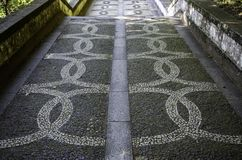 Typical stone floor of Lisbon. Typical stone floor Lisbon, detail of a typical floor with shapes and drawings, art Portugal, tourism royalty free stock photo