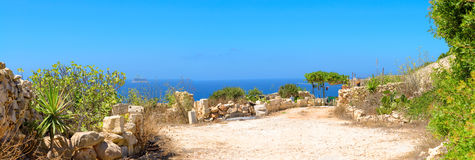 Typical stone shed facing the sea in Malta. Typical Maltese stone shed facing the sea on a bright sunny day. Malta, stone cliffs close to Zurrieq Royalty Free Stock Images