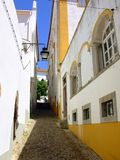Typical street of Évora v. Typical street of the city of situated Évora in the South of Portugal, capital of the Alentejo region considered património stock images