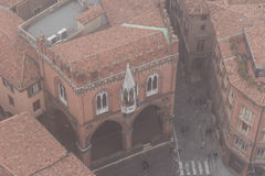 Typical street and buildings of Bologna in the fog. View from a narrow window of Asinelli Tower. Emilia Romagna , Italy. Royalty Free Stock Image