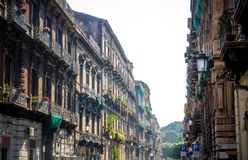 Typical street and buildings in old style, Catania, Sicily, Ital stock photos