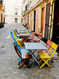 Typical street of Cadiz old town. Andalusia, Spain. Colorful chairs in a typical street of Cadiz old town. Andalusia, Spain Royalty Free Stock Image