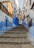 Typical street in Chefchaouen medina, Morocco. Stock Images