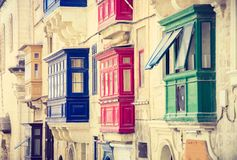 Typical street with colorful balconies in Valletta. Malta Royalty Free Stock Photo