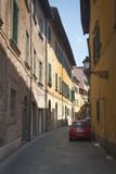 Typical street with Fiat car in Pisa, Italy Royalty Free Stock Photos