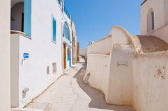 Typical street in Fira town on the Santorini island, Greece. Stock Photo