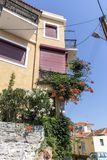 Typical street and houses at old town of city of Kavala, Greece. KAVALA, GREECE - JUNE 22, 2019:  Typical street and houses at old town of city of Kavala, East stock images