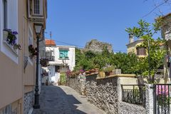 Typical street and houses at old town of city of Kavala, Greece. KAVALA, GREECE - JUNE 22, 2019:  Typical street and houses at old town of city of Kavala, East stock photos