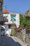 Typical street and houses at old town of city of Kavala, Greece. KAVALA, GREECE - JUNE 22, 2019:  Typical street and houses at old town of city of Kavala, East royalty free stock image