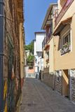 Typical street and houses at old town of city of Kavala, Greece. KAVALA, GREECE - JUNE 22, 2019:  Typical street and houses at old town of city of Kavala, East royalty free stock photo