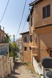 Typical street and houses at old town of city of Kavala, Greece. KAVALA, GREECE - JUNE 22, 2019:  Typical street and houses at old town of city of Kavala, East royalty free stock photos