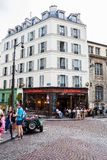 Paris street life and cafe`s. The typical street life of Paris in the summer, very busy and lots of people. Paris, France Royalty Free Stock Photo