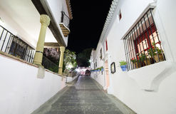 Typical street at night in the famous white village of Mijas, Malaga, Spain. Stock Photos