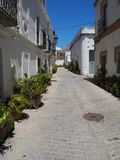 Typical Spanish street of buildings. Typical street in the pretty village of Tarifa, Andalucia, Spain Royalty Free Stock Photo