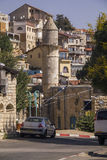 Typical street scene in Ancient Sefad,Israel. Safed, Israel - September 04, 2015: Typical street alley in Safed's old city with stone walls and blue coloured Royalty Free Stock Photos