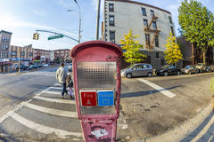 Typical street scene with emergency call phone in early morning Royalty Free Stock Photography
