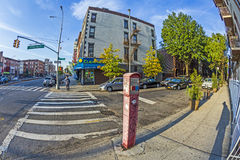 Typical street scene with emergency call phone in early morning Royalty Free Stock Photo