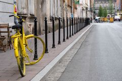 Yellow bicycle parked outside a coffee shop near Plac Nowy New Square in Kazimierz, the historic Jewish quarter of Krakow. Typical Street scene in Krakow stock images