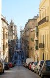 Typical Street in Valletta, Malta. VALLETTA, MALTA - JAN 14, 2014: panoramic view of narrow street in Valletta in Mediterranean sea Jan 14, 2014. Panoramic view Stock Images