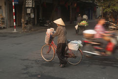 Typical street vendor in Hanoi,Vietnam. HANOI,VIETNAM-OCT 12 : Daily life of the appliance vendors sell on her bicycle in the typical street in old town on Stock Photo