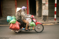Typical street vendor in Hanoi,Vietnam. HANOI,VIETNAM-OCT 12 : Daily life of the appliance vendors sell on her motorcycle in the typical street near old town on Stock Photo