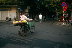 Typical street vendor in Hanoi,Vietnam. HANOI,VIETNAM-OCTOBER 12 : Daily life of the fruit vendors sell on her bicycle in the typical street near old town on Stock Photography