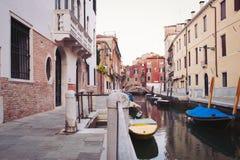 Typical street of Venice. Stock Photos