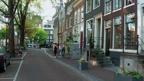 Typical street view in Amsterdam city center in the canal district - AMSTERDAM - THE NETHERLANDS - JULY 19, 2017. Typical street view in Amsterdam city center in stock video